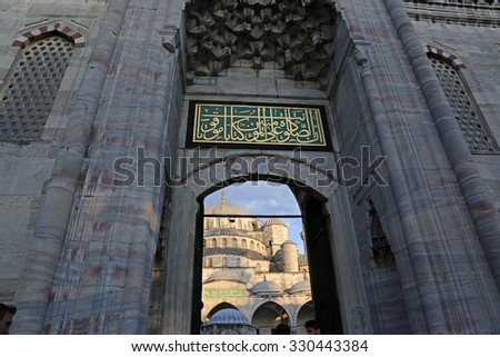 ISTANBUL, TURKEY - AUGUST 07, 2015: The Blue Mosque, shot through it's main gate.  Located in Istanbul, Turkey.  It was completed in 1616 by Sultan Ahmed I.  - stock photo