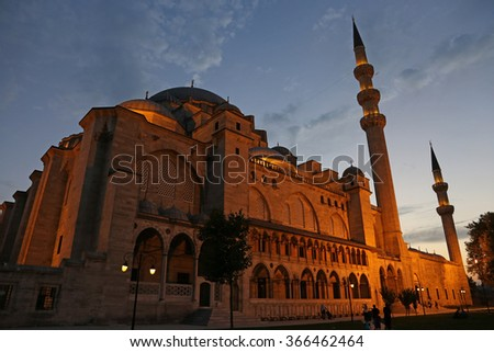 ISTANBUL, TURKEY - AUGUST 14, 2015: The exterior of the Suleymaniye mosque illuminated at dusk.  It is an Ottoman mosque completed in 1558.  - stock photo