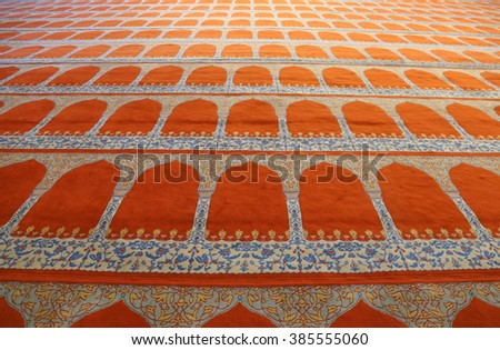 ISTANBUL, TURKEY - AUGUST 14, 2015: The prayer carpet of the Suleymaniye mosque.  It is an Ottoman mosque completed in 1558.  - stock photo