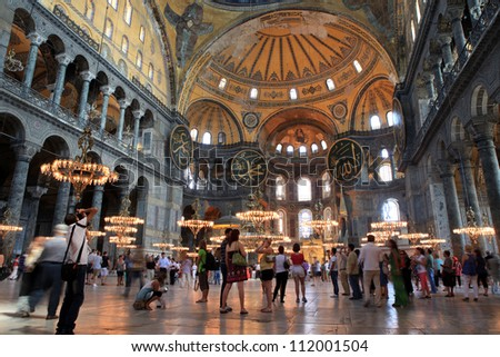 ISTANBUL,TURKEY - AUGUST 15: Tourists visit Hagia Sophia on August 15, 2012 in Istanbul, Turkey. Hagia Sophia is a former Orthodox patriarchal basilica, later a mosque and now a museum. - stock photo