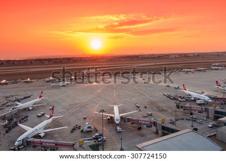 Istanbul, Turkey, August 18, 2015: Turkish Airlines Airplanes Boarding at Istanbul Ataturk Airport During Sunset - stock photo