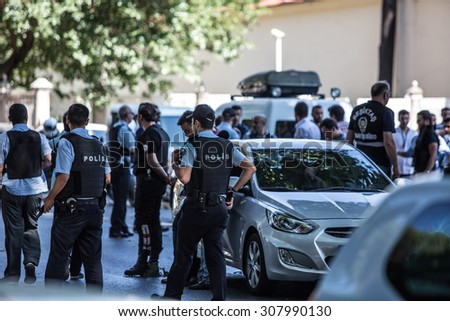 ISTANBUL, TURKEY - AUGUST 19: Turkish police arrest terrorist after shots fired at officers guarding Istanbul's Dolmabahce Palace on August 19, 2015 in Istanbul, Turkey.