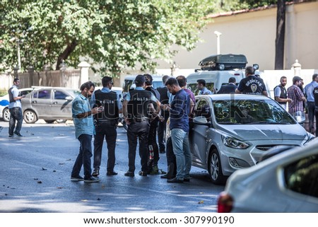 ISTANBUL, TURKEY - AUGUST 19: Turkish police arrest terrorist after shots fired at officers guarding Istanbul's Dolmabahce Palace on August 19, 2015 in Istanbul, Turkey. - stock photo