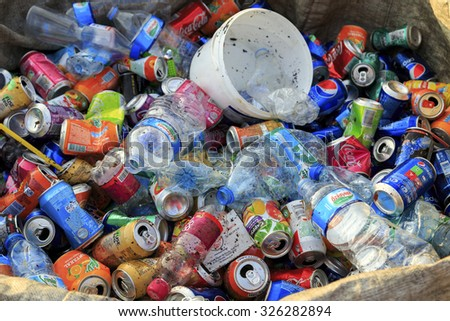 ISTANBUL, TURKEY - August 23, 2015: Used crushed beverage cans and plastic bottles in plastic garbage bags for recycling include popular brands,Istanbul,Turkey.