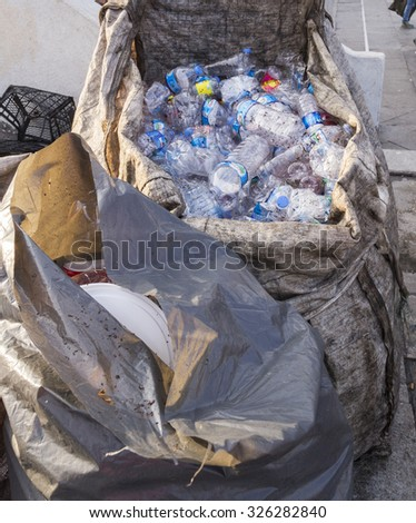 ISTANBUL, TURKEY - August 23, 2015: Used crushed water plastic bottles in plastic garbage bags for recycling include popular brands,Istanbul,Turkey.