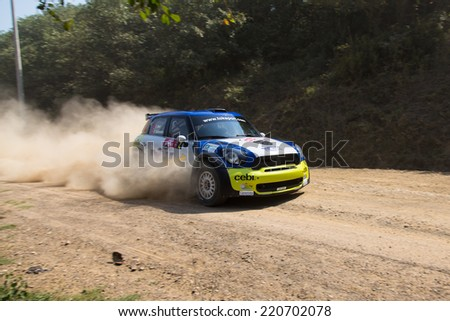 ISTANBUL, TURKEY - AUGUST 16, 2014: Yagiz Avci drives Mini Cooper JCW car of Tok Sport WRT in Avis Bosphorus Rally, Deniz Stage