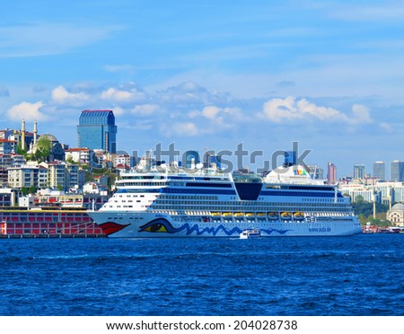 ISTANBUL, TURKEY -- CIRCA APRIL 2014: Cruise liner AIDA in Bosporus  on the modern building background - stock photo