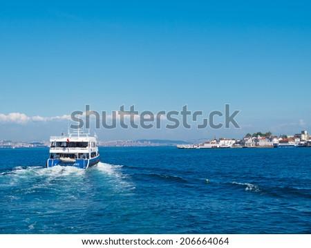 ISTANBUL, TURKEY -- CIRCA APRIL 2014: Sea of Marmara. Passenger ship sails around the island Heybeliada. - stock photo