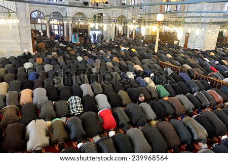 ISTANBUL, TURKEY - DEC 14: noon prayer in congregation male Muslims Fatih Mosque on December 14, 2014 in Istanbul, Turkey. Muslim Prayer is a prayer to the hair they do 5 times a day.