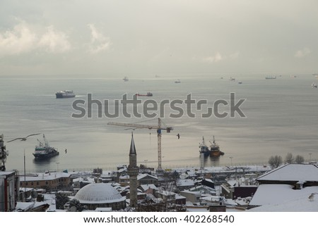 ISTANBUL,TURKEY - DEC 28:Panoramic view with dramatic sunset over roofs and Sea of Marmara in Istanbul on Dec 28, 2015 in Istanbul,Turkey. Istanbul is the world fifth-most-popular tourist destination. - stock photo