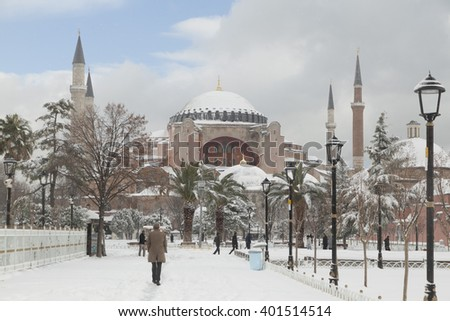 ISTANBUL,TURKEY - DEC 31 : Tourists visiting the Hagia Sophia in front of Sultan Ahmed Park on Dec 31,2015 in Istanbul, Turkey. Hagia Sophia is the greatest monument of Byzantine Culture. - stock photo