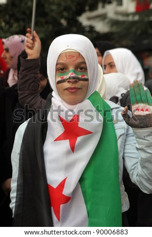 ISTANBUL,TURKEY-DECEMBER 2: An unidentified Syrian woman living in Istanbul protests the regime of Bashar Essad in front of Syrian Consulate on December 2, 2011 in Istanbul,Turkey. - stock photo