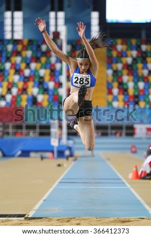 ISTANBUL, TURKEY - DECEMBER 26, 2015: Athlete Beyza Tilki triple jumps during Turkish Athletic Federation Indoor Athletics Record Attempt Races