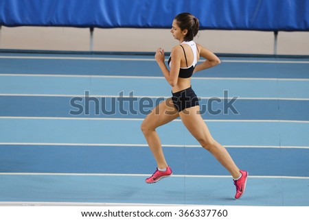 ISTANBUL, TURKEY - DECEMBER 26, 2015: Athlete Irem Zehra Karababa runs during Turkish Athletic Federation Indoor Athletics Record Attempt Races