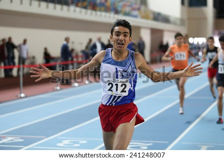 ISTANBUL, TURKEY - DECEMBER 28, 2014: Athlete Yener Aras after running during Athletics record attempt races in Asli Cakir Alptekin Athletics hall, Istanbul.