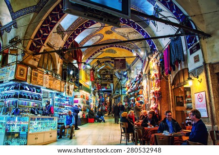 ISTANBUL, TURKEY - DECEMBER 13, 2014: Grand Bazaar with unidentified people shopping and eating. It is one of the largest and oldest covered markets in the world, with 61 covered streets, 3,000 shops