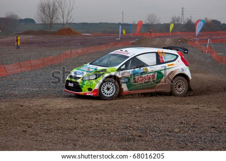ISTANBUL, TURKEY - DECEMBER 26: Murat Bostanci drives a Castrol Ford Team Turkiye Ford Fiesta S2000 car during Istanbul Rally Championship, SS Stage on December 26, 2010 in Istanbul, Turkey - stock photo