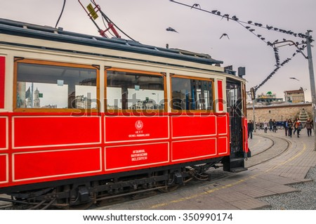 ISTANBUL, TURKEY - December 1: Old tram at Istiklal Avenue in Istanbul, Turkey on December, 2015.The Taksim Tunel Nostalgia Tram trundles along the istiklal street.