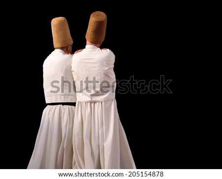 ISTANBUL, TURKEY - DECEMBER 14: Sufi whirling dervish (Semazen) dances, Commemoration of Mevlana Jalaluddin Rumi on December 14, 2013 in Istanbul. Semazen conveys God's spiritual gift to ritual. - stock photo