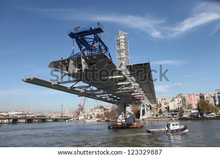 ISTANBUL, TURKEY-DECEMBER 26 : The ongoing construction of the Golden Horn Metro Bridge has been criticized for breaking city's skyline on December 26, 2012 in Istanbul,Turkey.