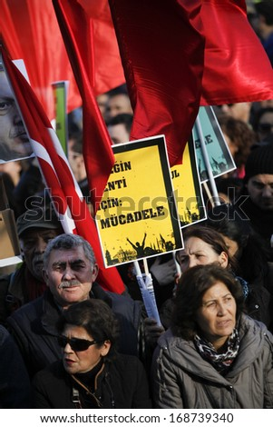 "ISTANBUL,TURKEY-DECEMBER 22:Thousands protest against corruption and government on 22 December, 2013 in Istanbul, Turkey. Aprotester holds a placard that reads""fight for the city"""