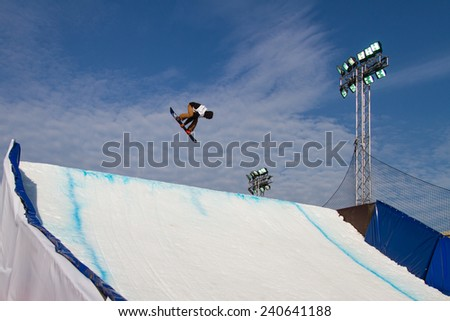 ISTANBUL, TURKEY - DECEMBER 20, 2014: Unidentified snowboarder jump in FIS Snowboard World Cup Big Air. This is first Big Air event for both, men and women.