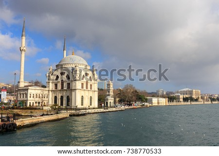 ISTANBUL, TURKEY -FEB 1, 2013: Dolmabahce Camii Mosque on the European coast of the Bosphorus strait. The mosque's construction was completed in 1855, it was opened for prayer services.