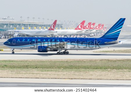 ISTANBUL , TURKEY - FEBRUARY 9, 2015: Aircraft of Azerbaijan Airlines, is making taxi at Istanbul Ataturk International Airport on February 9, 2015 . Aircraft is a  Boing 767 - stock photo