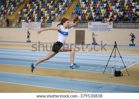 ISTANBUL, TURKEY - FEBRUARY 20, 2016: Athlete Buke Sirt triple jumps during Turkcell Turkish Indoor Athletics Championships