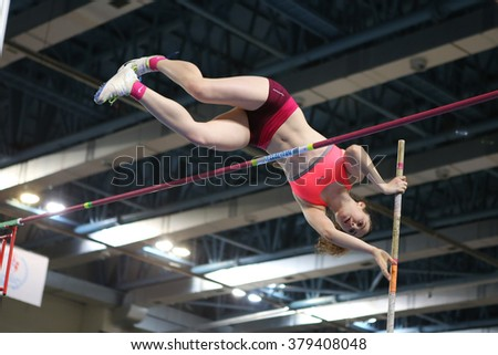 ISTANBUL, TURKEY - FEBRUARY 20, 2016: Athlete Busra Peksirin pole vaulting during Turkcell Turkish Indoor Athletics Championships - stock photo