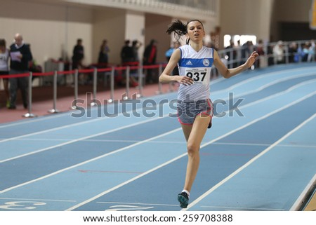 ISTANBUL, TURKEY - FEBRUARY 01, 2015: Athlete Damla Celik run during Turkish Athletic Federation Olympic Threshold Indoor Competitions in Asli Cakir Alptekin Athletics hall - stock photo
