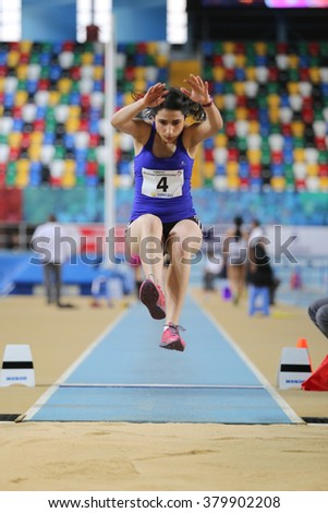 ISTANBUL, TURKEY - FEBRUARY 21, 2016: Athlete Damla Demir long jumps during Turkcell Turkish Indoor Athletics Championships