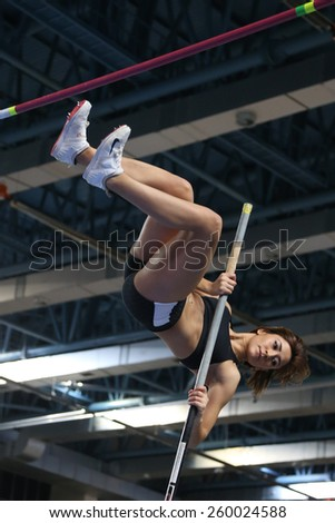 ISTANBUL, TURKEY - FEBRUARY 14, 2015: Athlete Elmas Seda Firtina pole vaulting during Turkcell Juniors and Seniors Athletics Turkey Indoor Championship in Asli Cakir Alptekin Athletics hall - stock photo