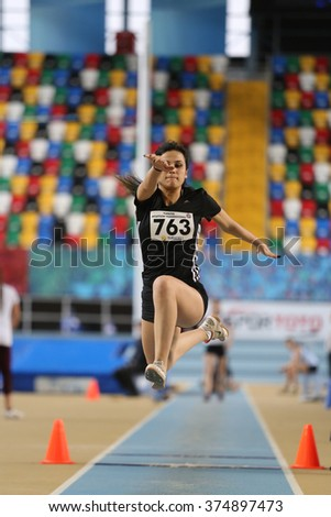ISTANBUL, TURKEY - FEBRUARY 06, 2016: Athlete Ezgi Karapinar triple jumps during Turkish Athletic Federation Clubs Indoor Championship