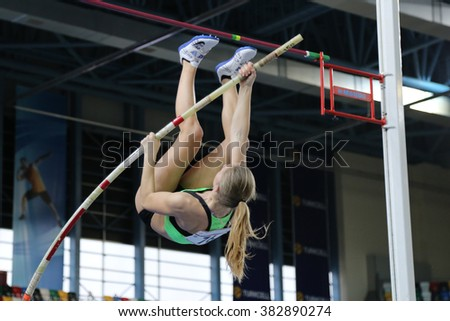 ISTANBUL, TURKEY - FEBRUARY 27, 2016: Athlete Nastja Modic pole vaulting in Balkan Athletics Indoor Championships - stock photo