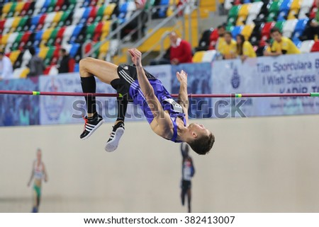 ISTANBUL, TURKEY - FEBRUARY 25, 2016: Athlete Raivydas Stanys high jumping in Athletics Istanbul Indoor Championships