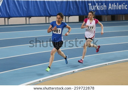 ISTANBUL, TURKEY - FEBRUARY 01, 2015: Athletes run during Turkish Athletic Federation Olympic Threshold Indoor Competitions in Asli Cakir Alptekin Athletics hall - stock photo