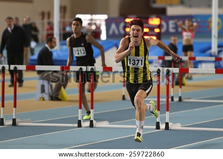 ISTANBUL, TURKEY - FEBRUARY 01, 2015: Athletes run steeplechase during Turkish Athletic Federation Olympic Threshold Indoor Competitions in Asli Cakir Alptekin Athletics hall