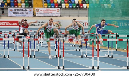 ISTANBUL, TURKEY - FEBRUARY 21, 2015: Athletes running during Balkan Athletics Indoor Championships in Asli Cakir Alptekin Athletics hall.