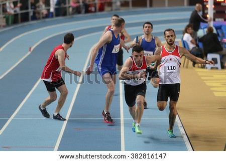 ISTANBUL, TURKEY - FEBRUARY 27, 2016: Athletes running 4x400 metres in Balkan Athletics Indoor Championships