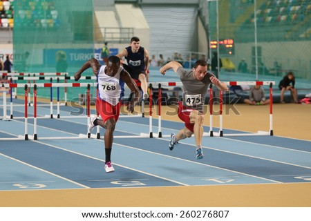 ISTANBUL, TURKEY - FEBRUARY 15, 2015: Athletes steeplechase running during Turkcell Juniors and Seniors Athletics Turkey Indoor Championship in Asli Cakir Alptekin Athletics hall