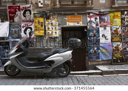 Istanbul, Turkey - February 2, 2015 : Back streets of Beyoglu.Walls covered with banners and posters and wait for the nightlife