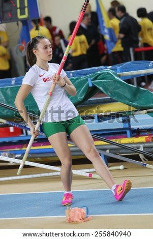 ISTANBUL, TURKEY - FEBRUARY 21, 2015: Bulgarian athlete Mania Bulkina pole vaulting during Balkan Athletics Indoor Championships in Asli Cakir Alptekin Athletics hall. - stock photo