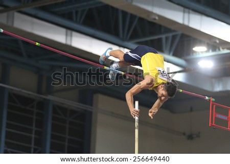 ISTANBUL, TURKEY - FEBRUARY 21, 2015: Cypriot athlete Nikandros Stylianou pole vaulting during Balkan Athletics Indoor Championships in Asli Cakir Alptekin Athletics hall. - stock photo
