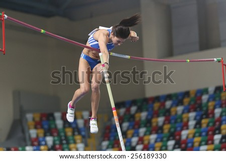 ISTANBUL, TURKEY - FEBRUARY 21, 2015: Greek athlete Lorela Manou pole vaulting during Balkan Athletics Indoor Championships in Asli Cakir Alptekin Athletics hall. - stock photo