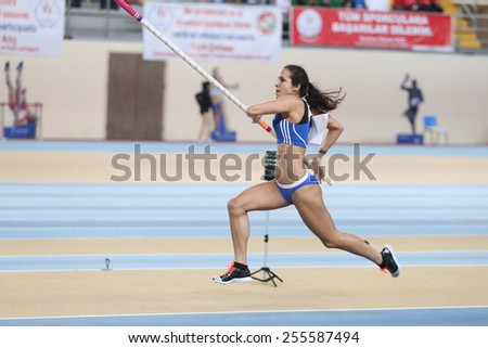 ISTANBUL, TURKEY - FEBRUARY 21, 2015: Greek athlete Stela Iro Ledaki pole vaulting during Balkan Athletics Indoor Championships in Asli Cakir Alptekin Athletics hall. - stock photo