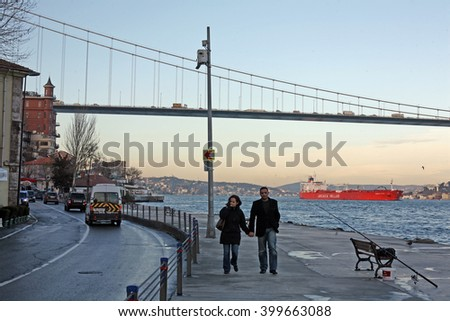 ISTANBUL, TURKEY - FEBRUARY 11: Lovers walking at Rumeli Fortress Seaside in Bosphorus on February 11, 2010 in Istanbul, Turkey. - stock photo
