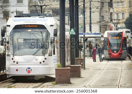 ISTANBUL,TURKEY, FEBRUARY 25, 2015:Modern tram passing through Sirkeci Station in Fatih District, one of the most crowded regions of Istanbul, Turkey. - stock photo