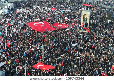 ISTANBUL, TURKEY - FEBRUARY 13: Thousands Turkish and Azeri citizen protest Hocali genocide in Taksim Square on February 13, 2012 in Istanbul, Turkey.