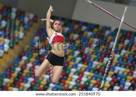 ISTANBUL, TURKEY - FEBRUARY 21, 2015: Turkish athlete Demet Parlak pole vaulting during Balkan Athletics Indoor Championships in Asli Cakir Alptekin Athletics hall. - stock photo